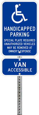 Massachusetts handicapped parking sign with details of the penalty for offenders