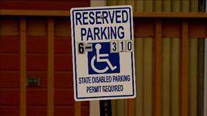 Reserved parking sign with permit number
