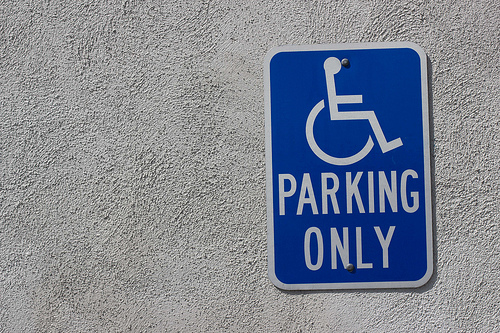Handicapped parking only sign on textured wall