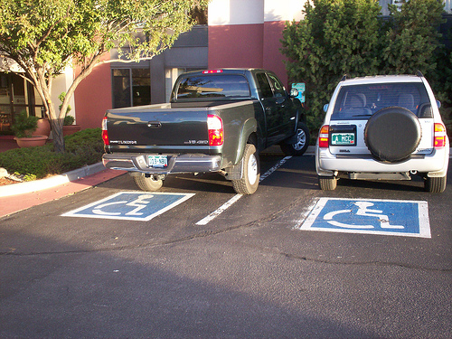 two cars in handicapped parking