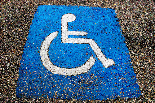 international symbol of accessibility painted on pavement